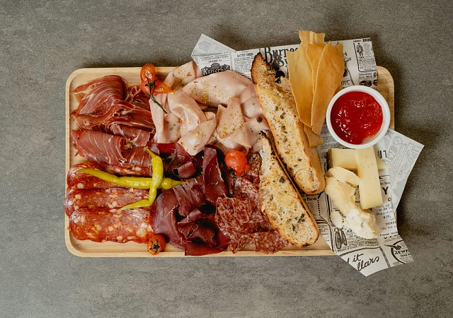 Plate of Italian coldmeat and cheeses with our focaccia